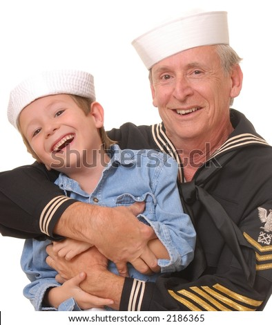 Old U.S. Navy sailor with his son - stock photo
