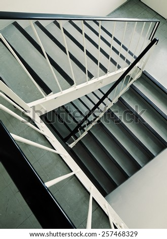 Old ugly and dirty staircase of a 1960s apartment building. - stock photo