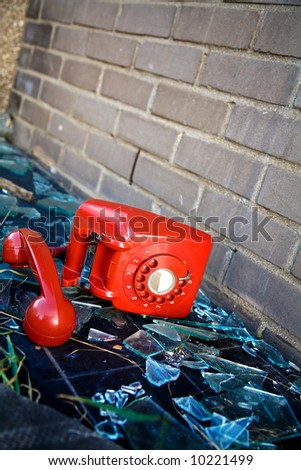 Old UK red phone abandoned in a derelict old building - stock photo