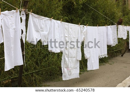 old underwear hanging out to dry - hang out the washing - clothes-line with ancient linen - stock photo
