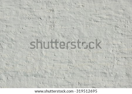 Old Uneven Brick Wall With White Painted Plaster Background  Texture Closeup - stock photo