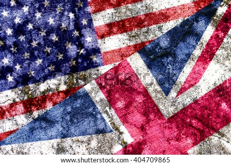 Old United Kingdom and USA grunge flag painted on a wall - stock photo