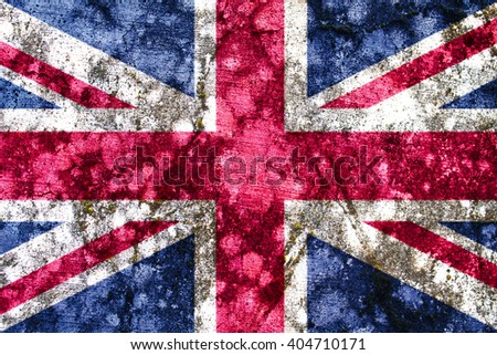 Old United Kingdom grunge flag painted on a wall - stock photo