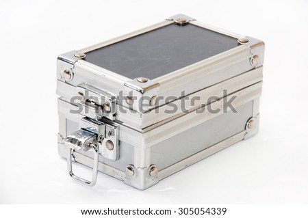 Old unlocked aluminum suitcase.