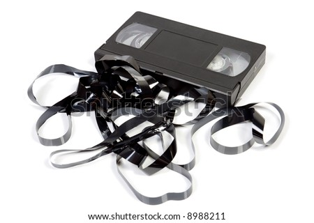 Old unusable vhs cassette isolated on white - stock photo
