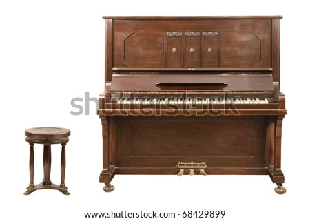 Old upright german piano and a stool isolated over white background. Both clipping paths are included. - stock photo