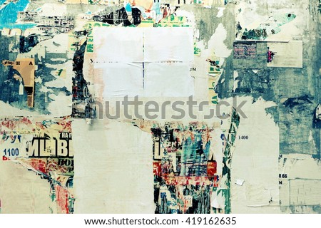 Old Urban Street Billboard With Torn Posters And Stickers, Background Or Texture With Copy Space, Toned Image - stock photo