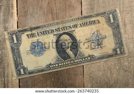 Old US dollar on the wooden table, without banking elements - stock photo
