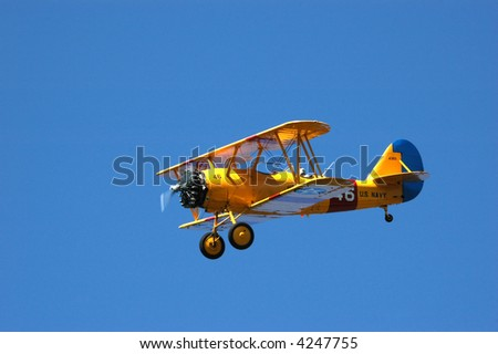 Old US Navy Model N3N Trainer Against Blue Sky - stock photo