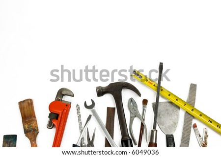 Old used and worn tools isolated over white - stock photo