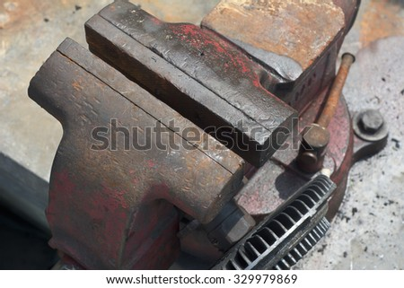 Old Used Bench Vise Made of Cast Iron - stock photo