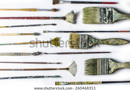 Old used brush for drawing on a white background - stock photo