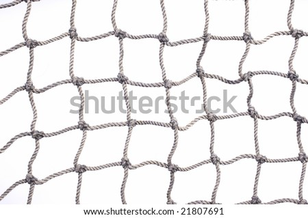 Old used fishing net with lots of loose hemp fibers left intact. On a white background. - stock photo