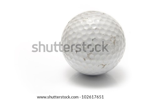 Old used golf ball isolated on white - stock photo