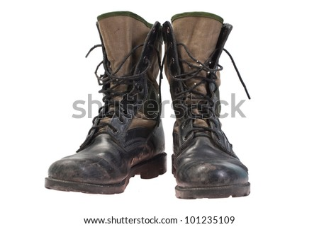 old used jungle boots isolated - stock photo