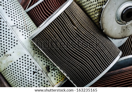 Old, used oil filter of a car engine close up - stock photo