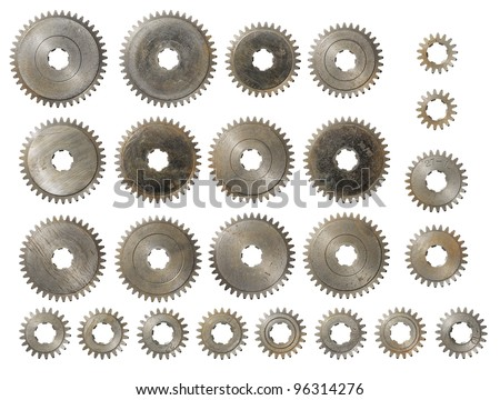 Old used steel cog gears isolated on white. - stock photo