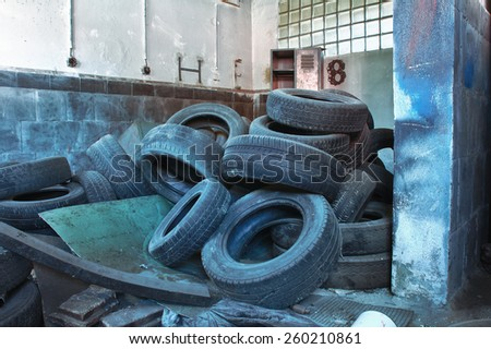 Old used tires,photo from demolition  textile  factory  - stock photo