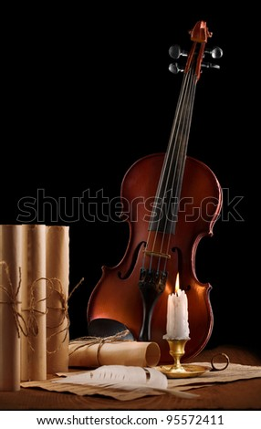 old used violin with antique items - stock photo