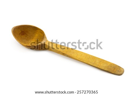 Old used wooden spoon isolated on white background - stock photo