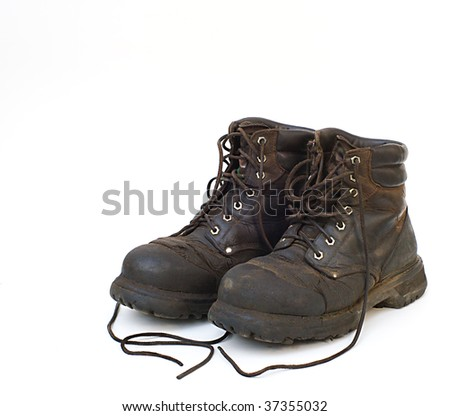 Old used work boots on white background - stock photo