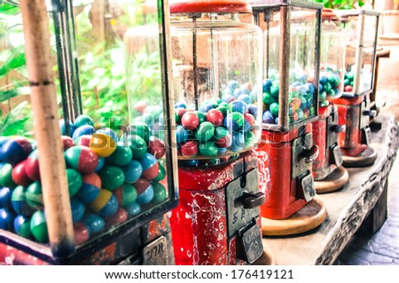 Old vending balls machines - stock photo