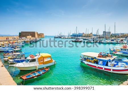 Old venetian harbor with boats in Heraklion, Crete island, Greece - stock photo