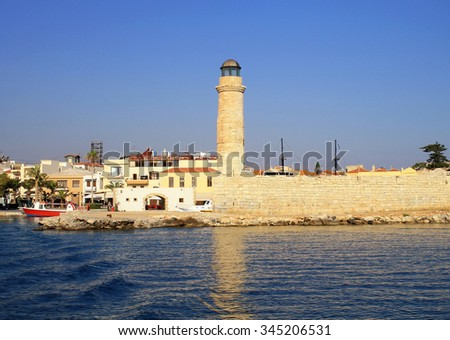 Old venetian lighthouse at harbor, Rethymno, Crete, Greece - stock photo