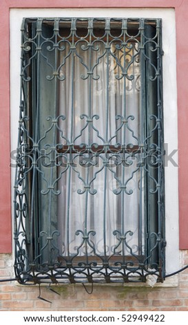 Old Venice Window with metal bars - stock photo