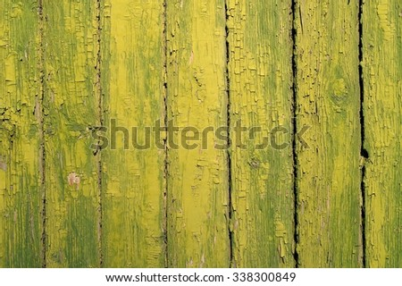 Old vertical planks painted green yellow copyspace - stock photo