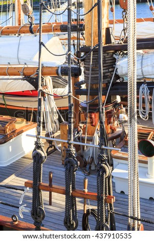 Old vessel sail ship - deck and ropes, rigging on a wooden sailboat - detail close up - stock photo