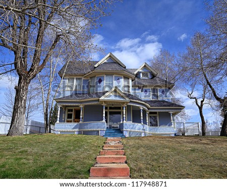 Old Victorian blue house - stock photo