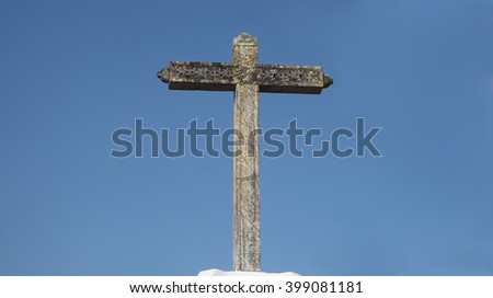 Old Victorian gravestone catholic cross at Cashel cemetery stand against blue sky  - stock photo
