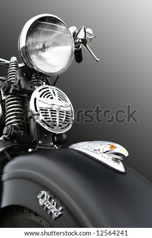Old Vietnam era motorcycle with hawk icon on the front - Clipping Path Included - stock photo