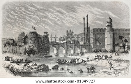 Old view of Saligmarh fort and Red fort in Delhi, separated by Yamuna river and linked by arched bridge. Created by De Bar, published on L'Illustration, Journal Universel, Paris, 1857 - stock photo