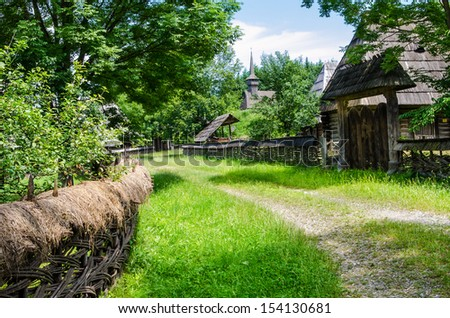 Old vilage in Maramures, Romania. Romanian traditional architectural style, life in the countryside.