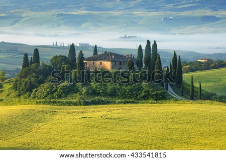old villa in golden sun lights in Tuscany in Italy - stock photo