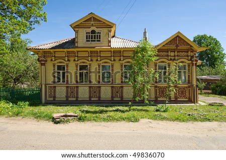 old village house in sunny day with blue sky, Russia.