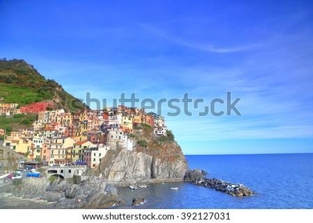 Old village of Manarola at dusk, Cinque Terre, Italy - stock photo