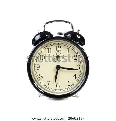 old vintage alarm clock isolated on white background