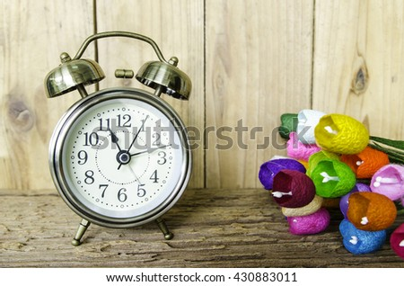 Old vintage alarm clock with bells,and old wooden background