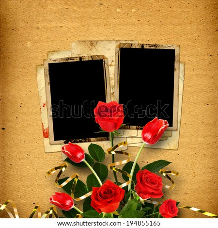 Old vintage album for photos with a bouquet of red roses and tulips - stock photo