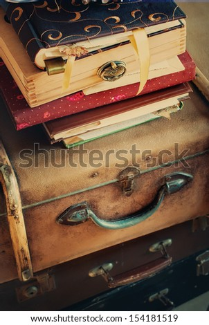 Old Vintage Albums and Trunks, vertical, toned image - stock photo