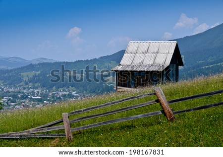 Old vintage alone house on the top view from beautiful mountains - stock photo