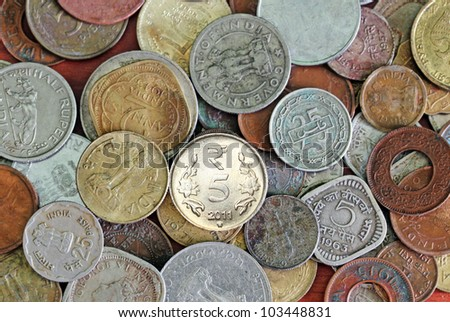 Old, vintage and new indian coins background - stock photo