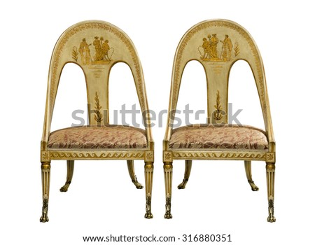 Old vintage antique Egyptian painted chairs isolated on white