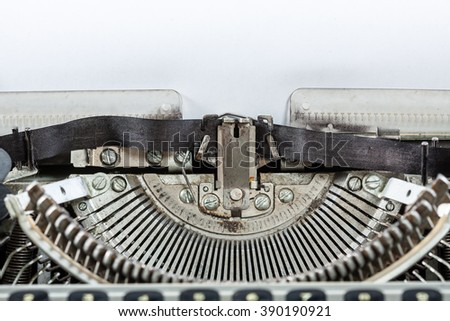 Old vintage antique typewriter machine with paper for text. Writer creation concept.