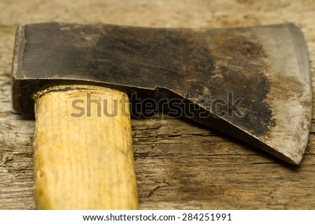 old vintage axe on wooden background, close-up - stock photo
