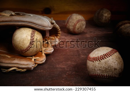 Old Vintage Baseball Background. Focus on ball in glove - stock photo