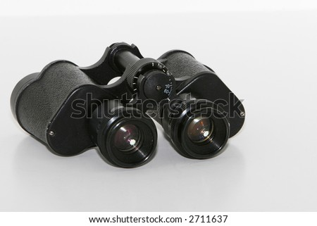 Old vintage binauculars isolated on white, showing wear and tear, with dust and grime